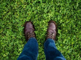 Man with brown shoes in the grass