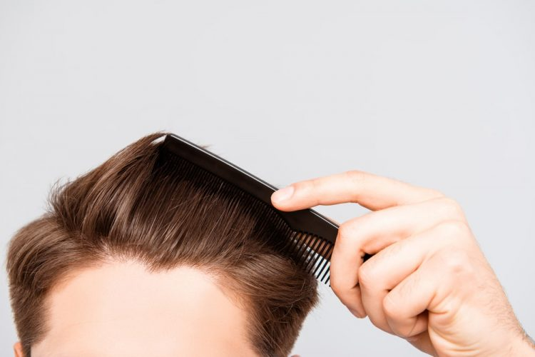 combing hair with a comb