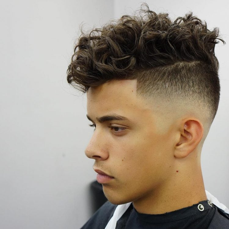 man with curly hair in a quiff