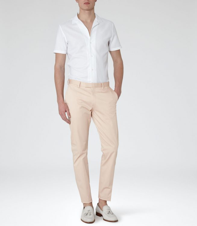 Man in White Cuban Collar Shirt and nude trousers