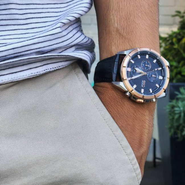 Man on stripes shirt with a classy watch