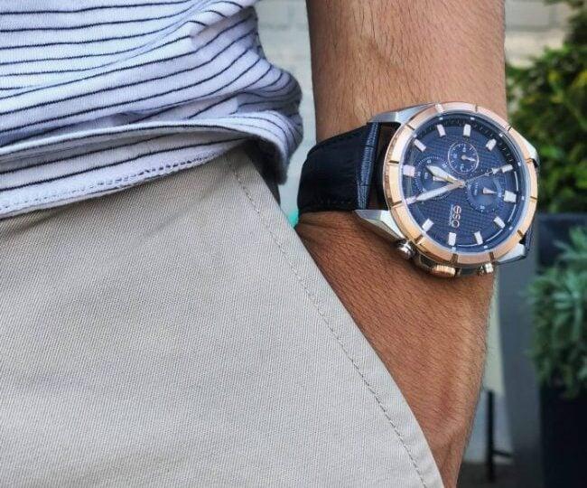 Man on stripe shirt wearing classy watch