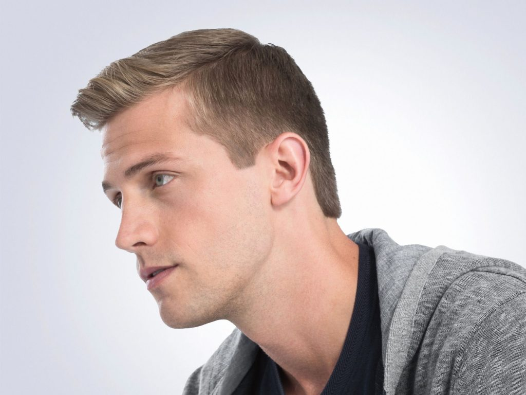man with a gray hoodie and a dapper haircut