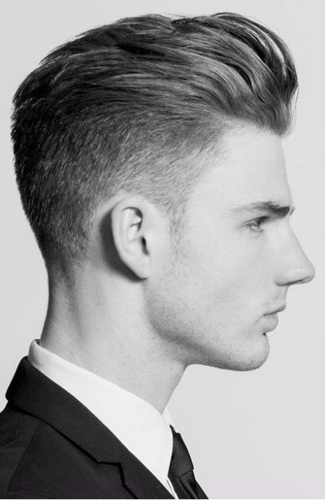 Man in a suit with a dapper haircut