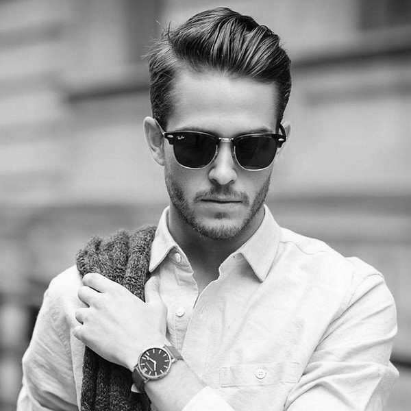 man with a dapper haircut and sunglasses