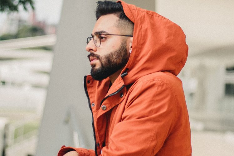 Stylish man in orange safari jacket