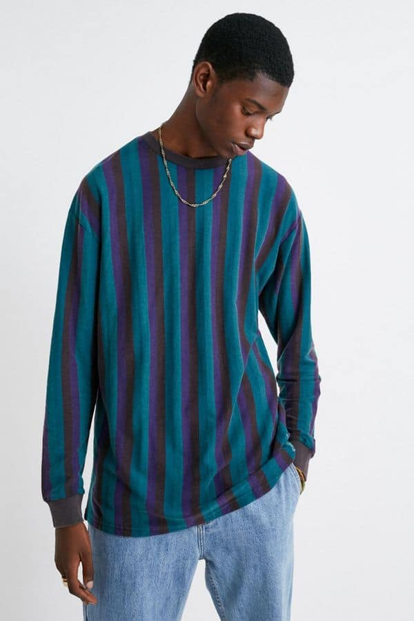 Man with long sleeved striped shirt