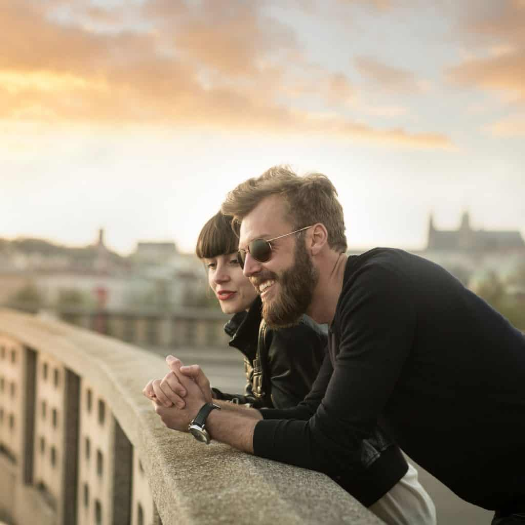 bearded man on bridge with a woman