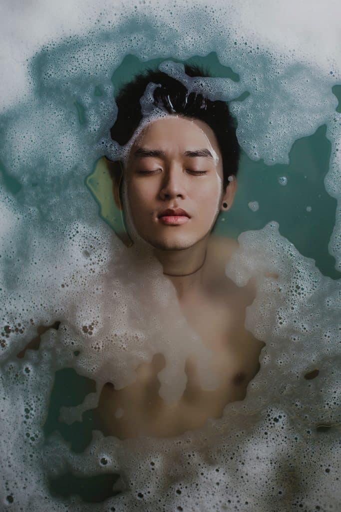clean shaving man bathing