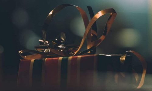 Gift box with striped wrapper