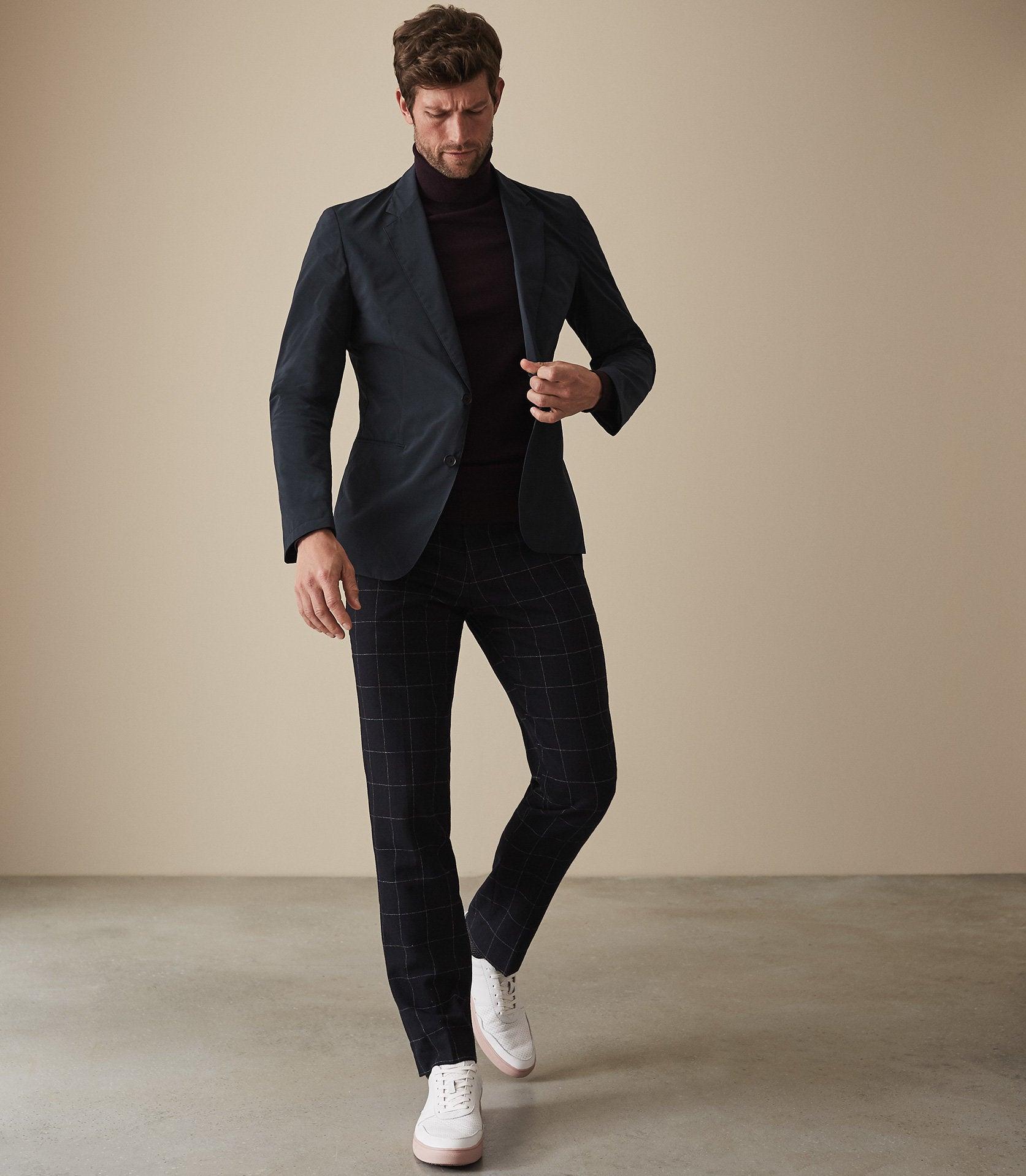 Men wearing black blazer and checkered black pants