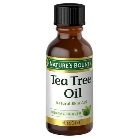 Tea tree oil in brown bottle and black cap