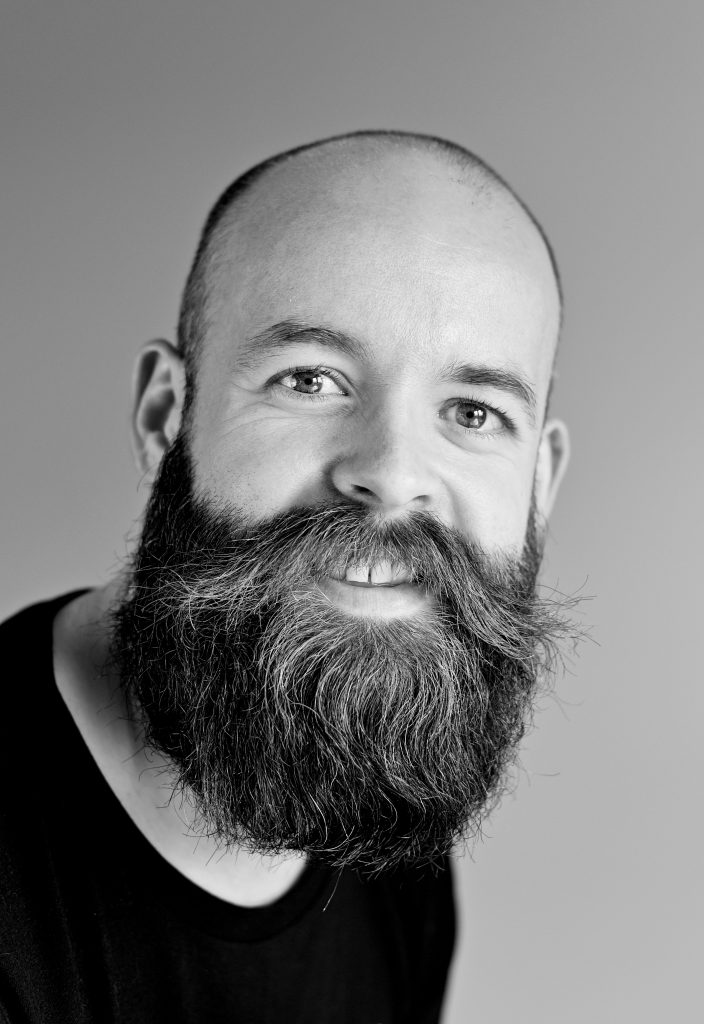 man with buzz cut and beard