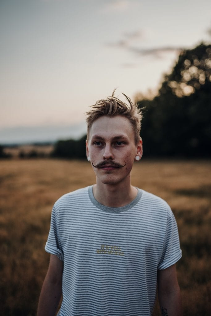 blond man with mustache