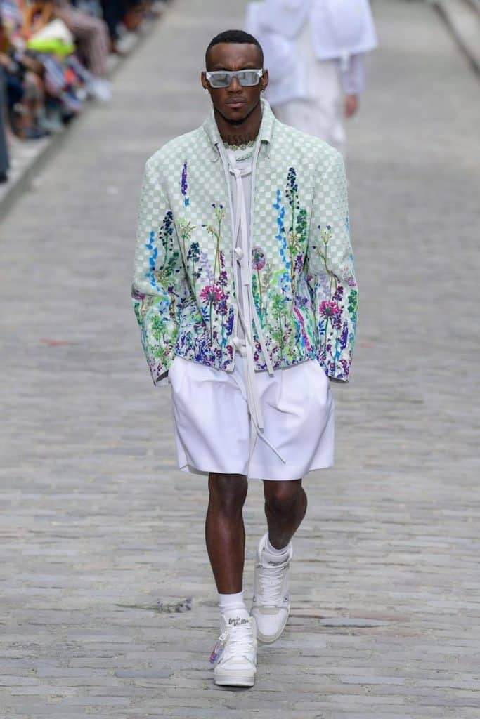 Man wearing a Louis Vuitton floral jacket and white shorts for SS20