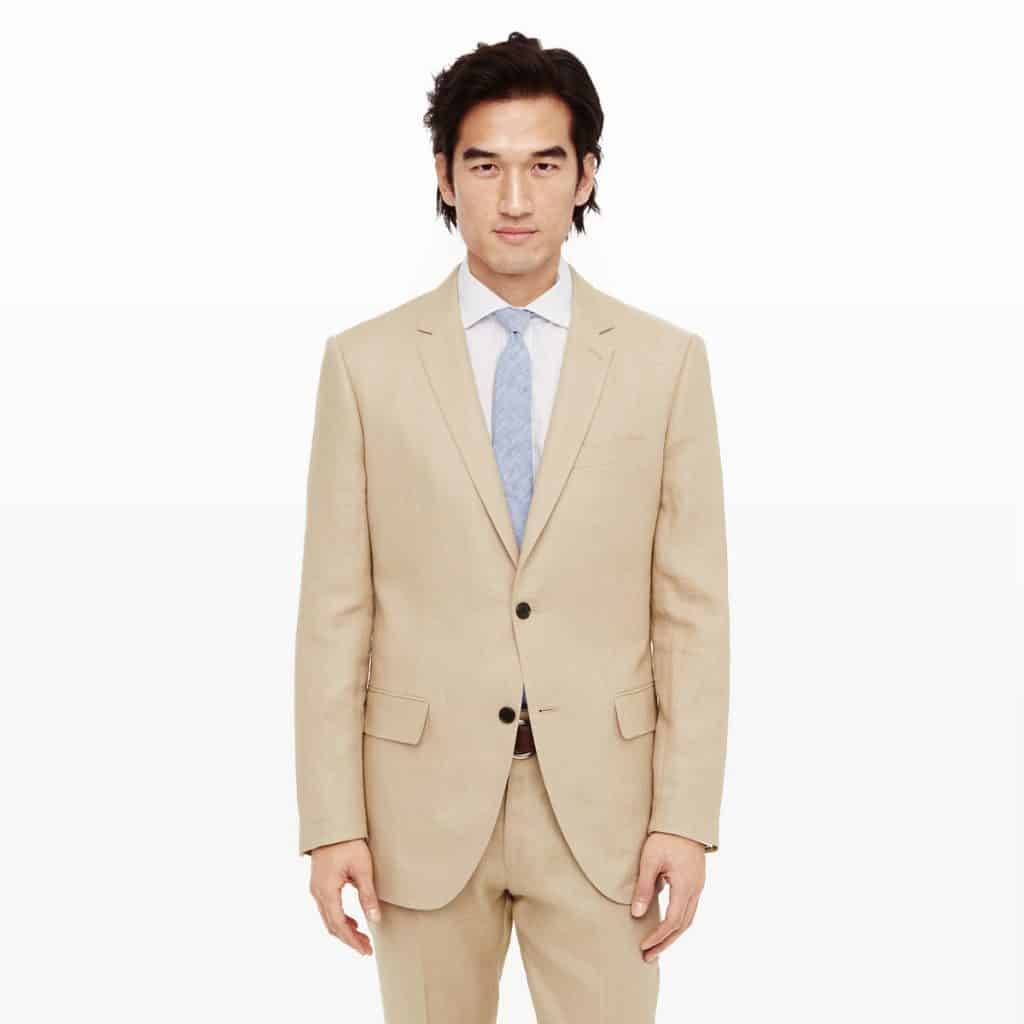 Man wearing a light brown Club Monaco cocktail suit