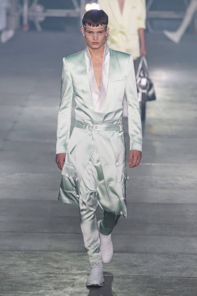 Man wearing a light green satin trousers for SS20