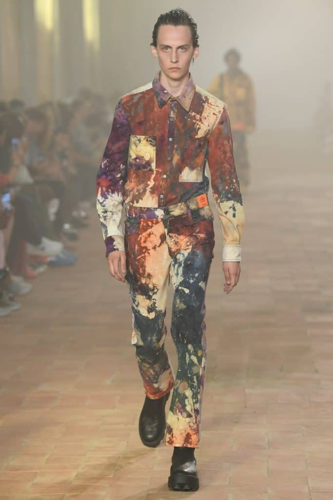Man wearing a splattered pattern top and trousers