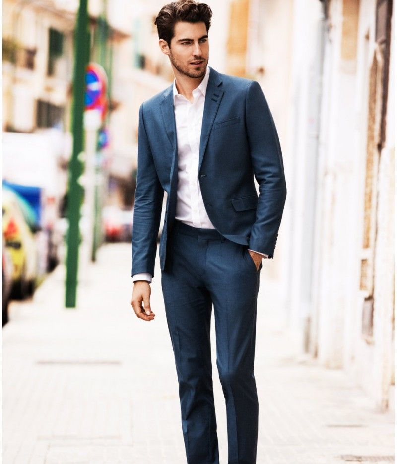 Man wearing an H&M dark blue cocktail suit
