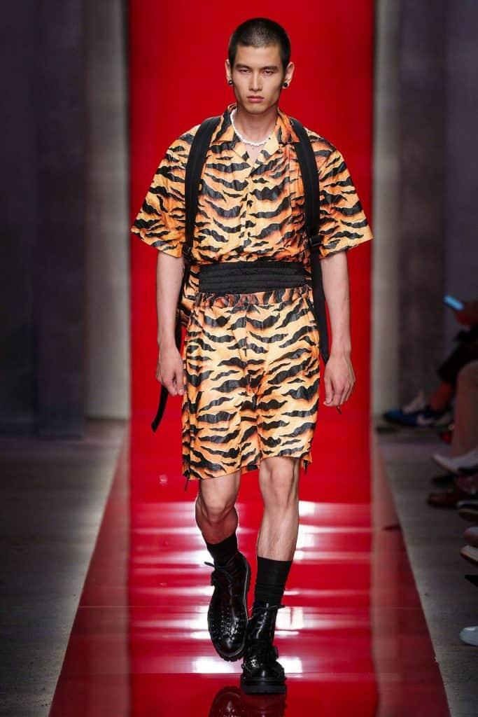 Man wearing an orange animal print trousers SS20