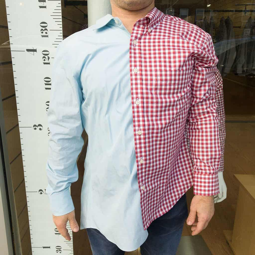 Photo of a man wearing a long sleeve polo with red checkered print on the side and plain light blue on the other side