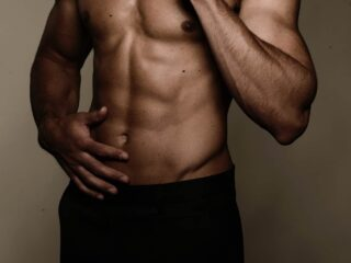 man with a six pack wearing black underwear