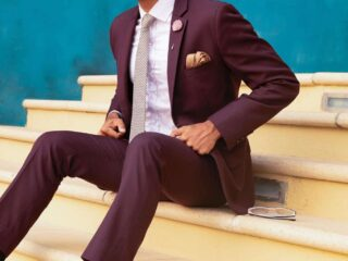 man sitting on stairs with cocktail suit