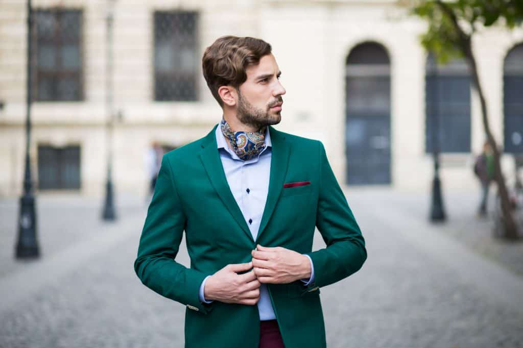 man with a green jacket and silk scarf
