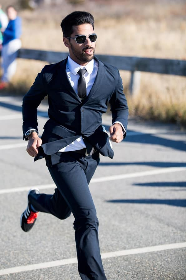 man in suit running in running shoes