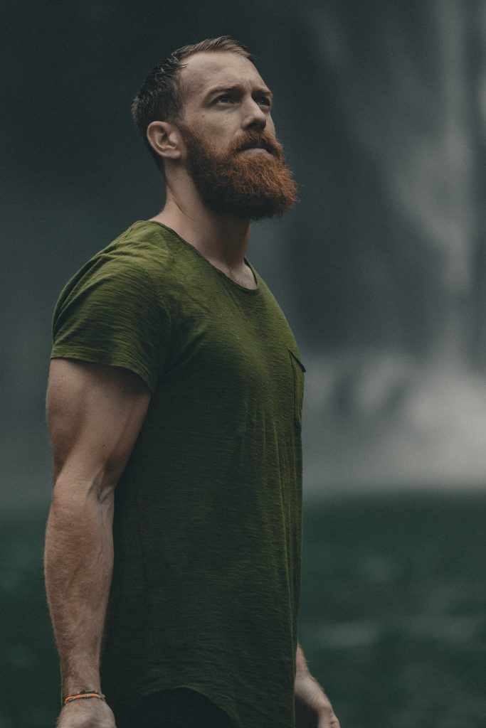 man with a green t-shirt and a well trimmed beard