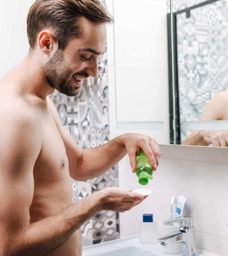 man-applying-aftershave-with-cotton-ball