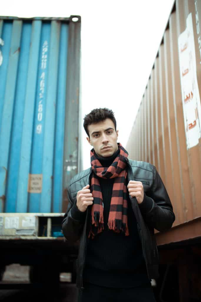 man with leather jacket and plaid scarf