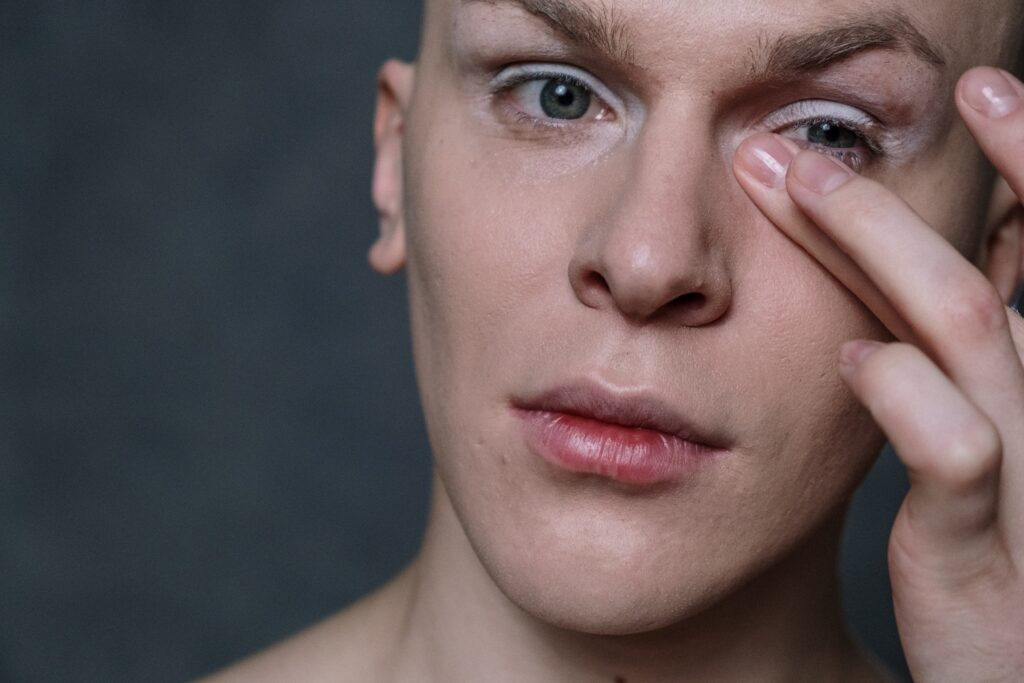 man with eye cream