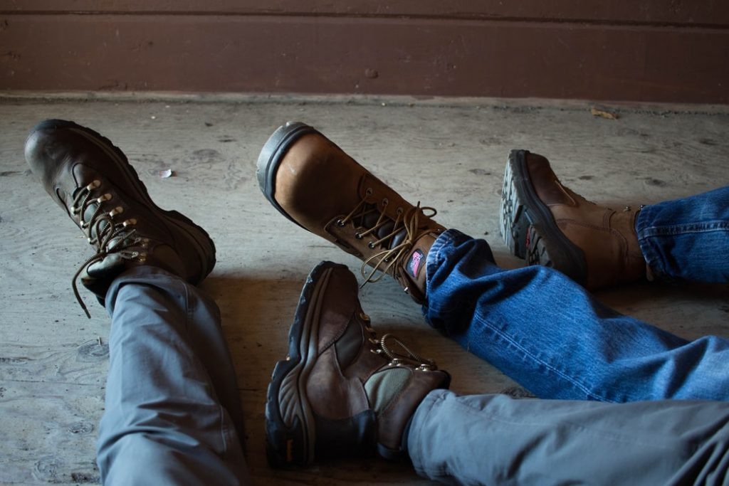 A photo of two men wearing boots