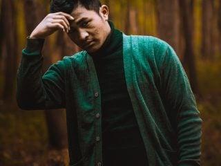 man in green cardigan