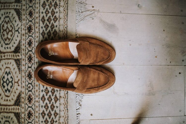 man standing wearing loafers