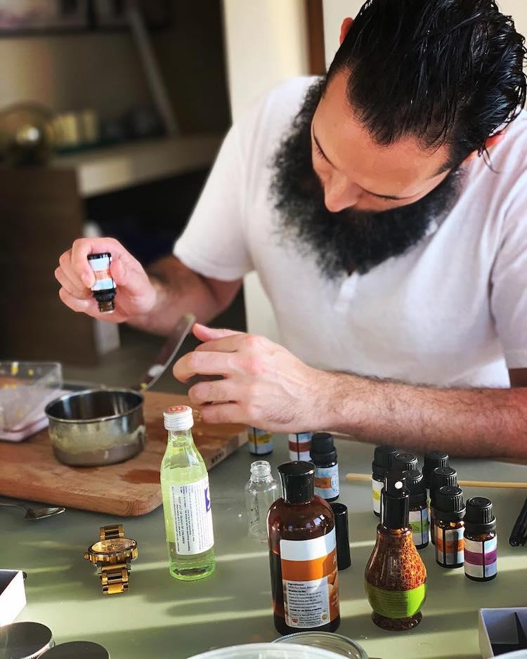 man making beard balm