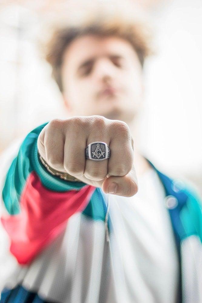 man showing off ring