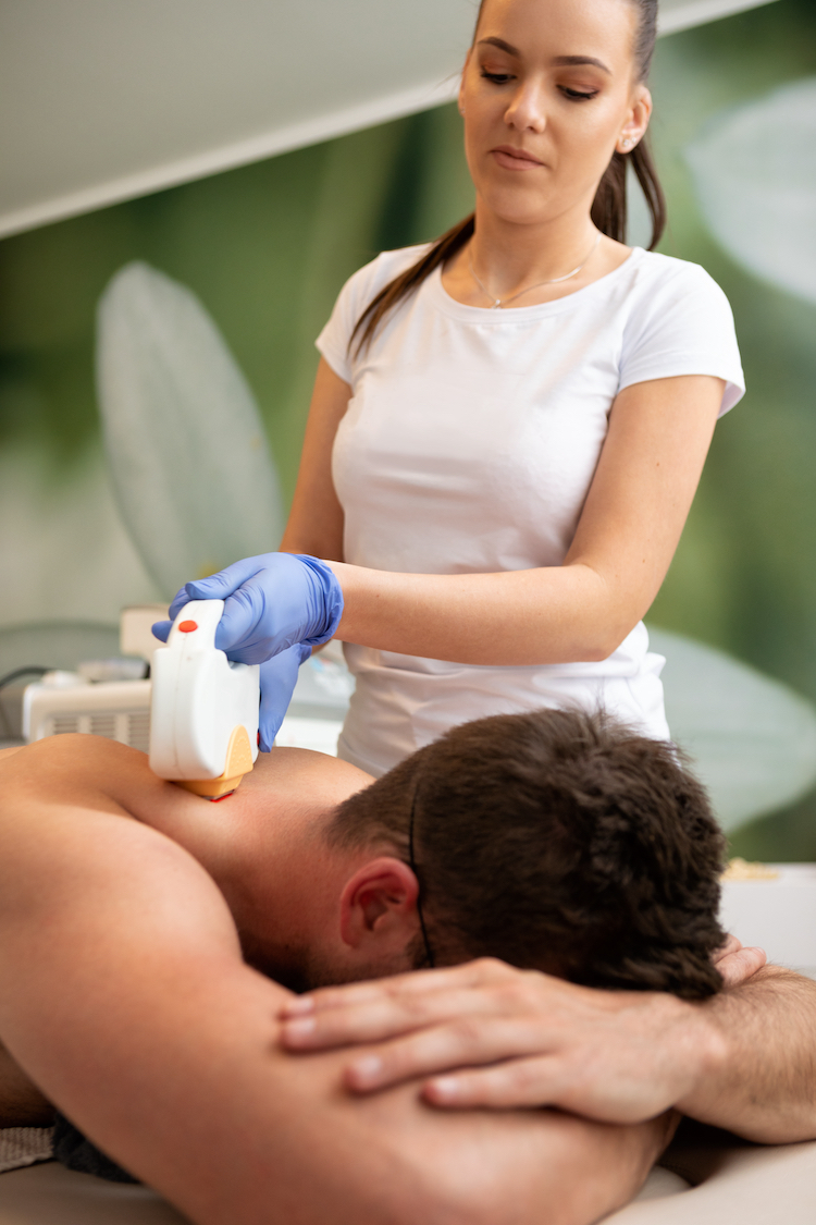 Man undergoing laser hair removal treatment